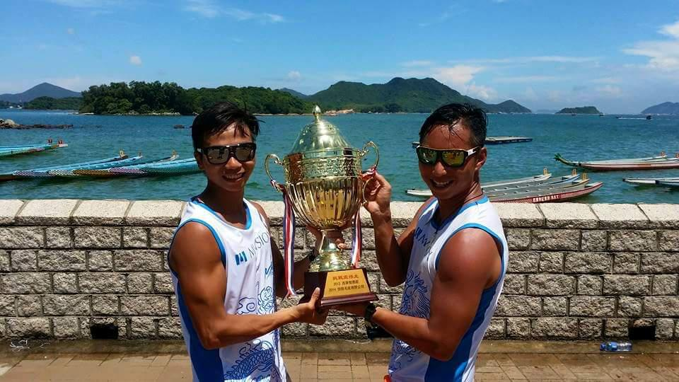 Bryan Ng (right) and colleague with trophy won at recent dragonboat races
