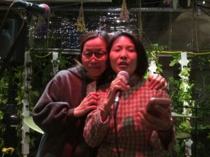 Debbie Chow (in grey) with friend translating